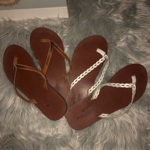 TWO PAIRS OF AMERICAN EAGLE FLIP FLOPS